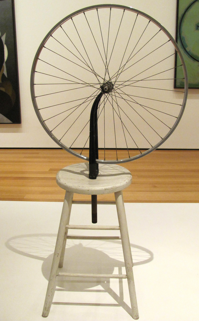 "Marcel Duchamp, Bicycle Wheel, 1951 (after a lost original from 1913), metal wheel mounted on a painted wood stool, 51"" x 25"" x 16½"", Museum of Modern Art, New York, photo by rocor [flickr] Creative Commons Attribution license."