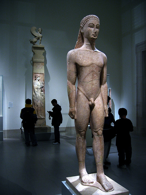 """Marble Statue of a kouros (youth), c. 590-580 BCE, marble, 76⅝"""" h, Metropolitan Museum of Art, New York, Photo by Cåsbr, Flickr, Creative Commons Attribution License."""