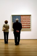 Visitors at the Museum of Modern Art in New York admire Flag by Jasper Johns, Photo by Leo Reynolds, Flickr, Creative Commons Attribution License.