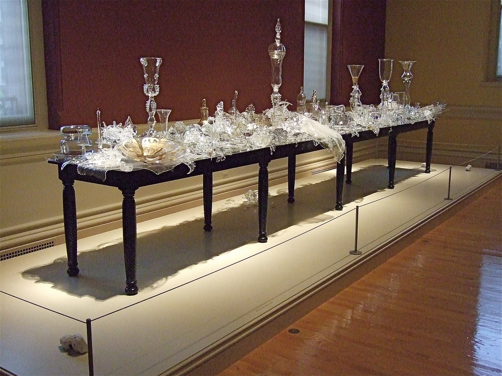 """Beth Lipman, Banquet, 2003, glass, oak, oil and mixed media, 72"""" x 240"""" x 33"""", Smithsonian American Art Museum, Washington, D.C., Photo by catface3 via Flickr, Creative Commons Attribution-NonCommercial-ShareAlike 2.0 Generic License."""
