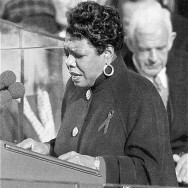 "Maya Angelou reciting her poem, ""On the Pulse of Morning"", at President Bill Clinton's inauguration in 1993, Photo by NPR via the White House, Public Domain via Wikimedia Commons."