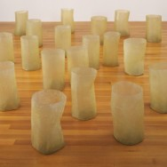 "Eva Hesse, Repetition Nineteen III, 1968, fiberglass and polyester resin, nineteen units, Each 19 to 20 1/4"" x 11 to 12 3/4"" in diameter, MoMA, New York."