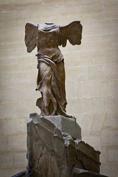 "Nike of Samothrace, c. 200-190 BCE, Parian Marble, 96"" high, Louvre Museum, Paris, Photo by jimmyweee via Wikimedia Commons, uploaded by russavia, CC BY 2.0."