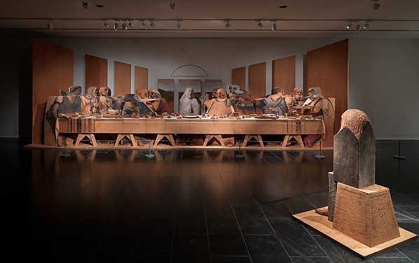 "Marisol, Self-Portrait Looking at the Last Supper, 1982-4, Wood, plywood, stone, plaster, aluminum, dye, charcoal, 121 ½"" x 358"" x 61"", Metropolitan Museum of Art, New York, Photo via the Metropolitan Museum of Art."