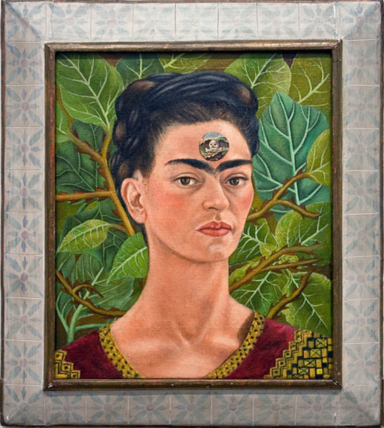 "Frida Kahlo, Thinking About Death, 1943, oil on canvas, 17.5"" x 14.5"", Private Collection, Mexico City, Photo by Matthew Kirkland via Flickr, Creative Commons Attribution-NonCommercial 2.0 Generic License."